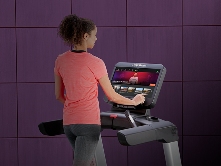 female-exerciser-on-integrity-treadmill-touching-SE3HD-screen